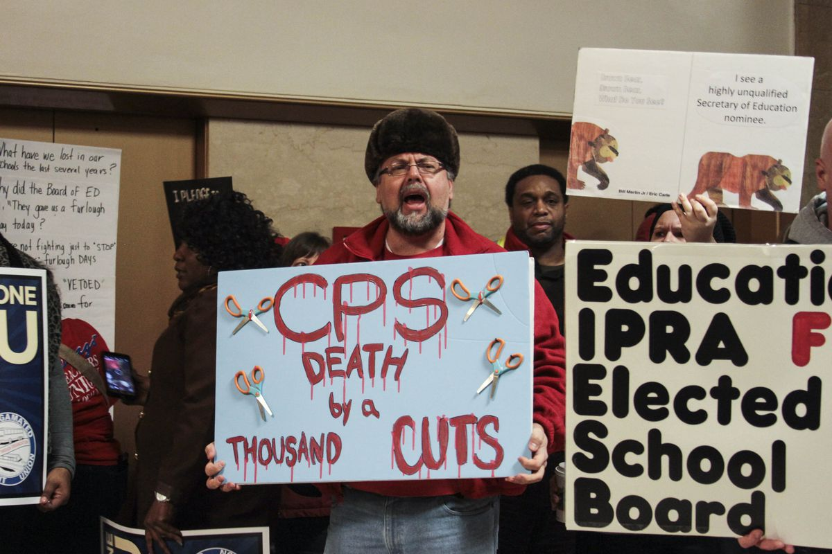 Craig Cleve, a bilingual teacher at Columbia Explorer Academy, joined other protesters at City Hall. | Maria Cardona/ Sun-Times