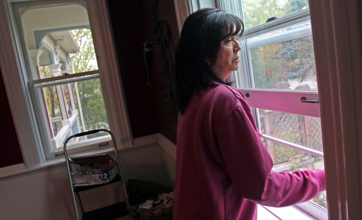 Blanche Richter said despite the contractor's assurances, some new storm windows on her historic home remain extremely difficult to open.   Tim Boyle/For the Sun-Times