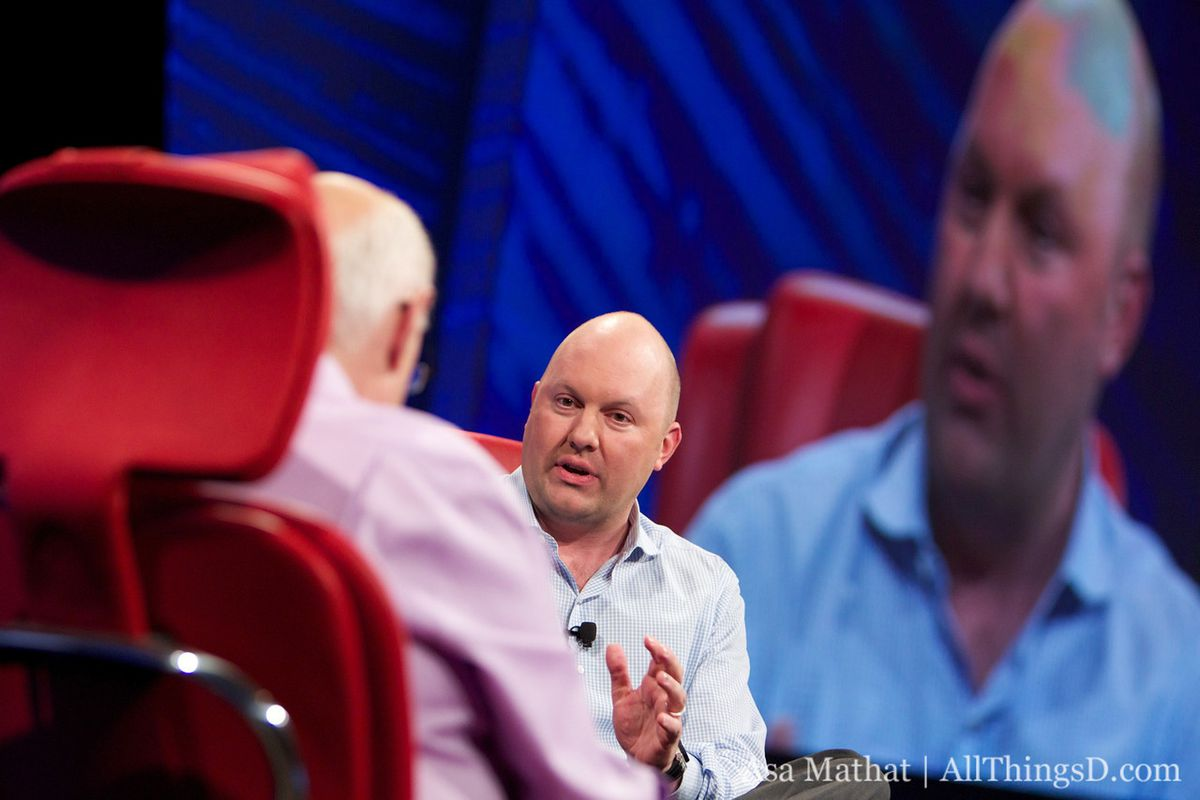 Mark Andreessen sits in a red chair onstage with Walt Mossberg at All Things D's ninth conference.
