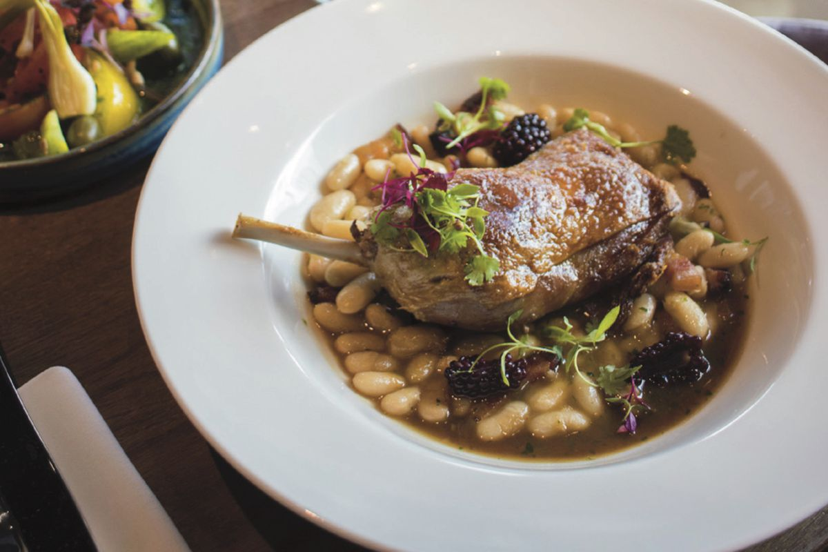 Confit duck leg with pancetta, blackberries and white beans at Maple in White City, London