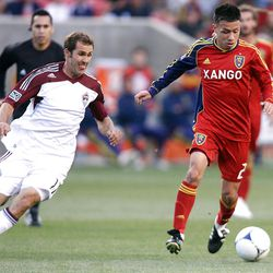 Sebastian Velasquez of Real Salt Lake battles for control of the ball against Brian Mullan of the Colorado Rapids during their MLS match up at Rio Tinto Stadium in Sandy Saturday, April 7, 2012.