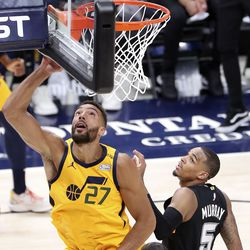 Utah Jazz center Rudy Gobert (27) shoots in front of San Antonio Spurs guard Dejounte Murray (5) during an NBA game at Vivint Smart Home Arena in Salt Lake City on Monday, May 3, 2021. The Jazz won 110-99.