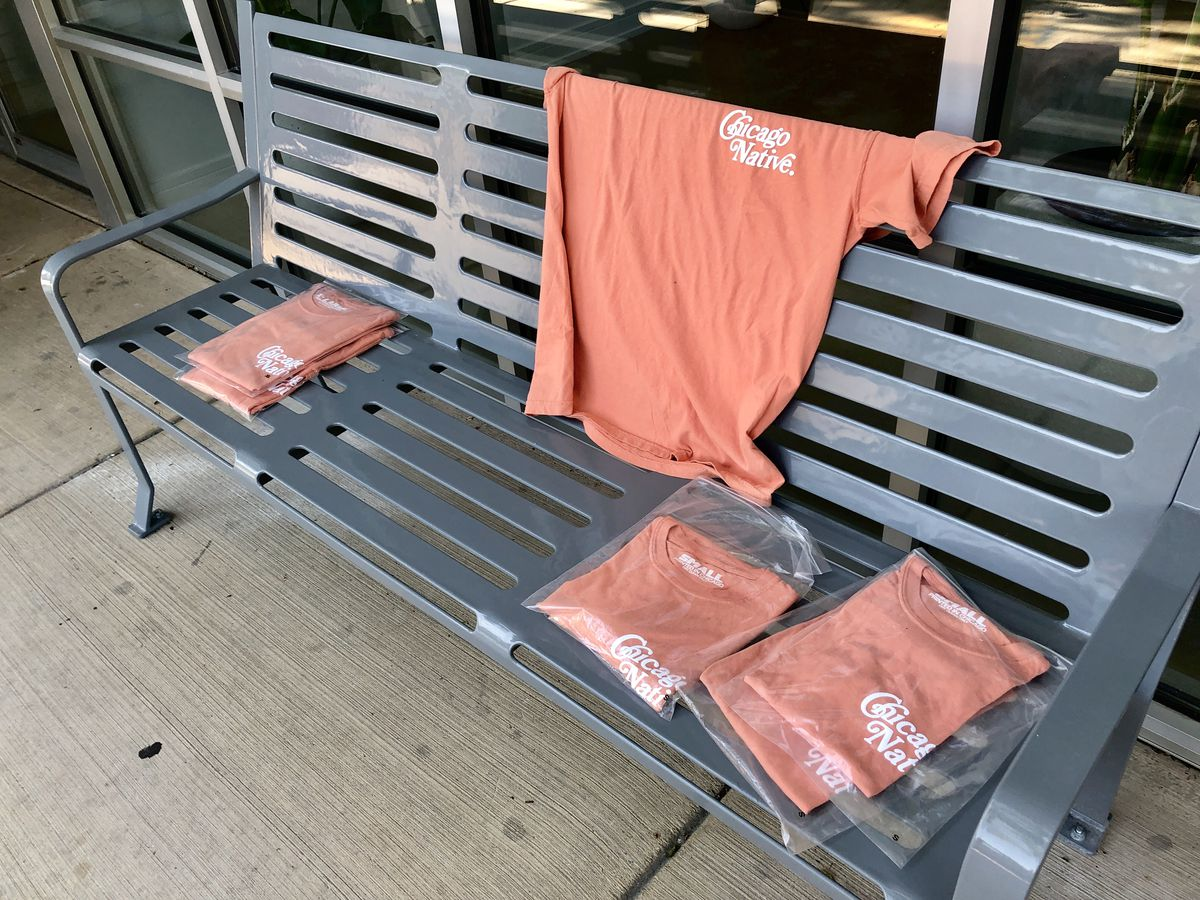 A bench with T-shirts left.