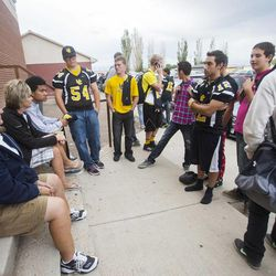 Union football players talk after receiving their jerseys back Wednesday, Sept. 25, 2013. Some players were told they wouldn't be playing in Friday's homecoming game. The football coaches at Union High in Roosevelt have taken a stand against poor performance in the classroom and bullying outside the classroom, including disrespect of teachers and students.