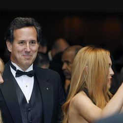 Former Sen. Rick Santorum and Lindsay Lohan, right, attend the White House Correspondents' Association Dinner headlined by late-night comic Jimmy Kimmel, Saturday, April 28, 2012 in Washington.