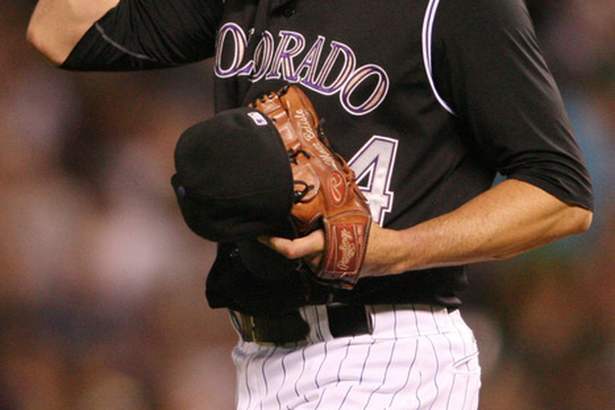 June 13, 2012; Denver, CO, USA; Colorado Rockies pitcher Matt Belisle (34) reacts on the mound during  the eighth inning against the Oakland Athletics  at Coors Field.  Mandatory Credit: Chris Humphreys-US PRESSWIRE