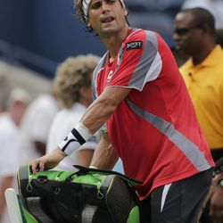 Spain's David Ferrer comments as he packs up his gear after a semifinal match against Novak Djokovic, of Serbia, was postponed because of approaching inclement weather at the 2012 US Open tennis tournament,  Saturday, Sept. 8, 2012, in New York.