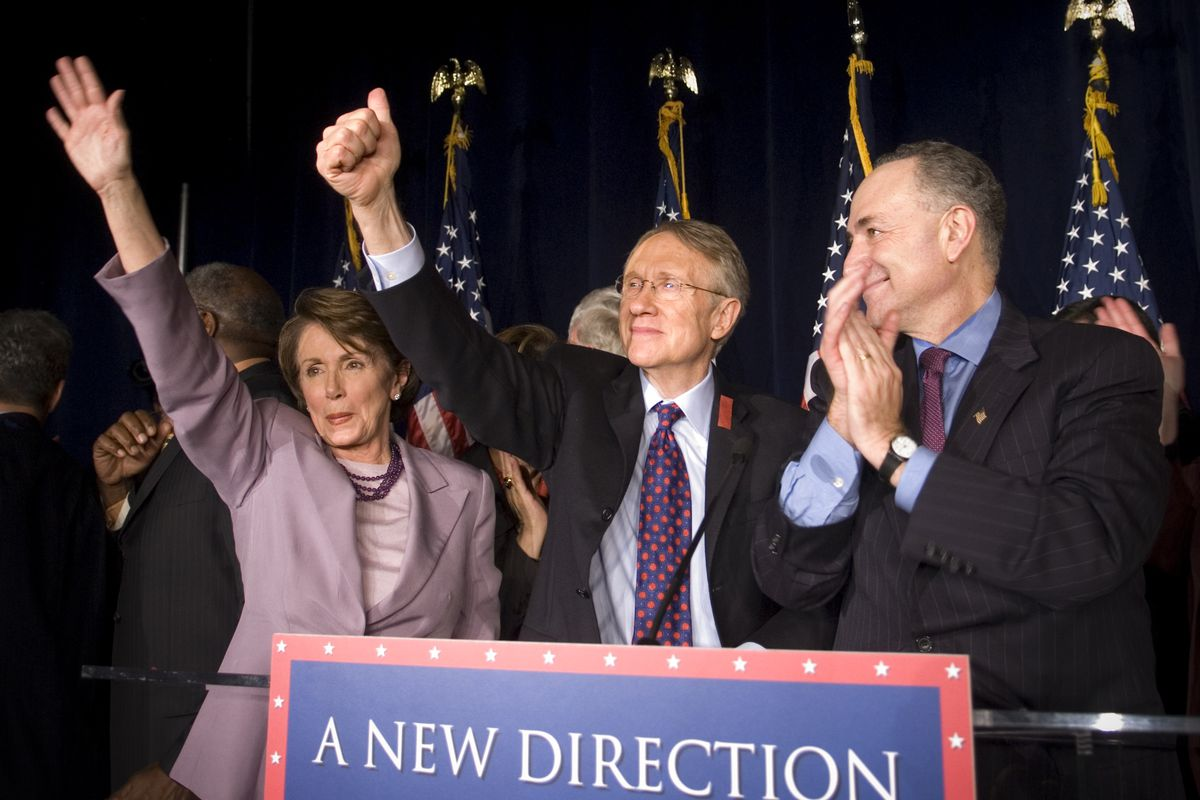 Rep. Nancy Pelosi (D-CA), waves to the crowd with Sen. Harry Reid (D-NV) and Sen. Chuck Schumer (D-NY) at a democratic election night watch party in Washington D.C., on November 7, 2006.