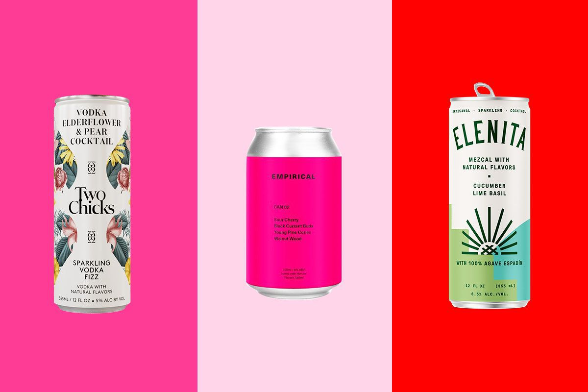 three canned cocktails on a pink and red background