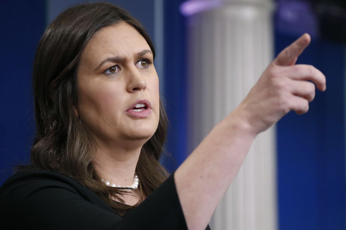 White House press secretary Sarah Huckabee Sanders gestures while speaking to the media during the daily briefing in the Brady Press Briefing Room of the White House, Thursday, June 14, 2018.