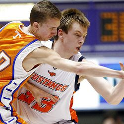 Timpview's Ryan Sagers (left) battles for the ball with Mountain Crest's Troy Pickett in Saturday's 4A state tournament title game.