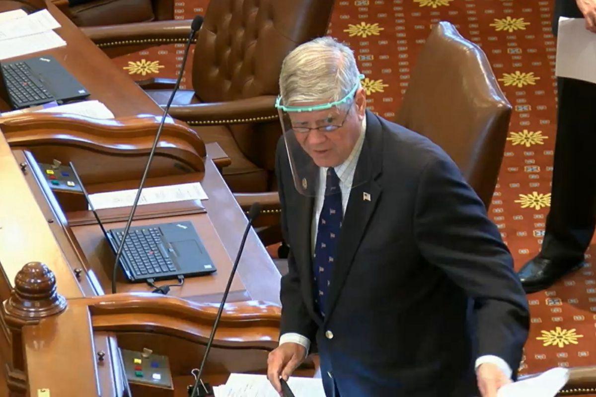 State Sen. Jim Oberweis, R-Sugar Grove, addresses the Senate through a face shield on Thursday.