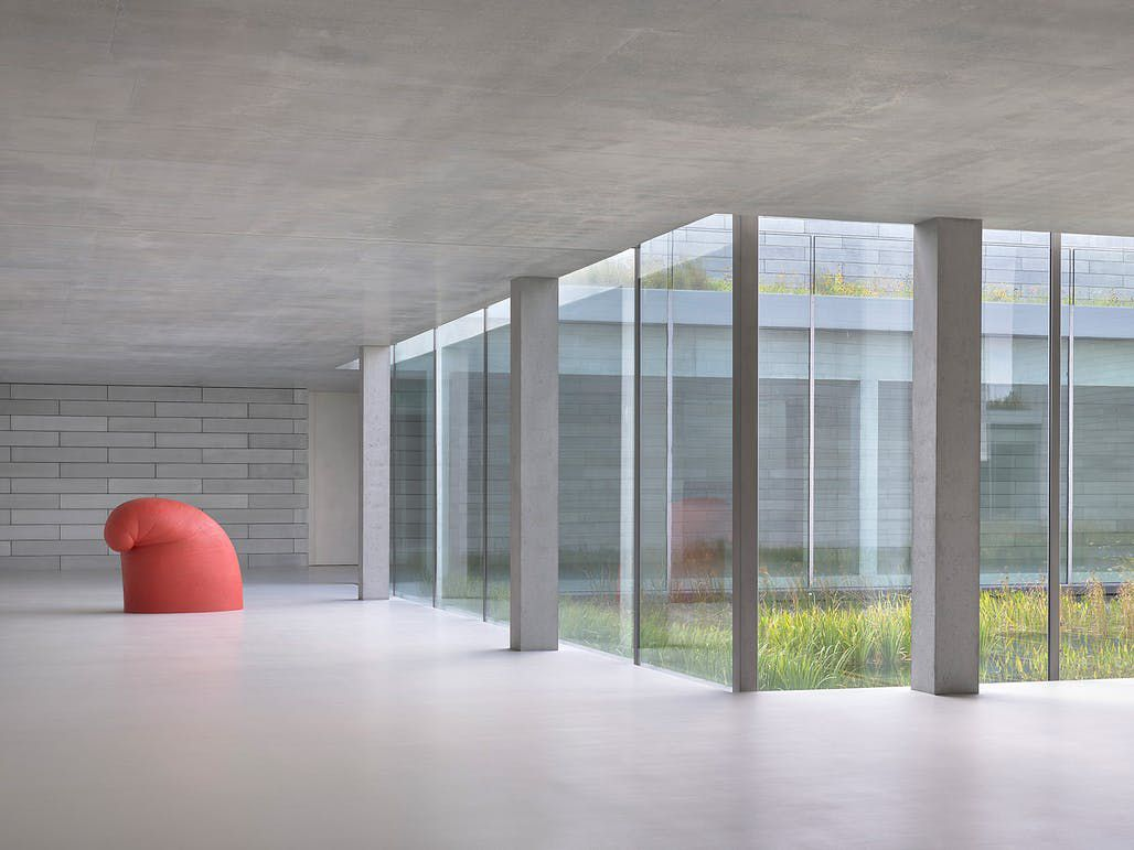 Stone lobby with red sculpture