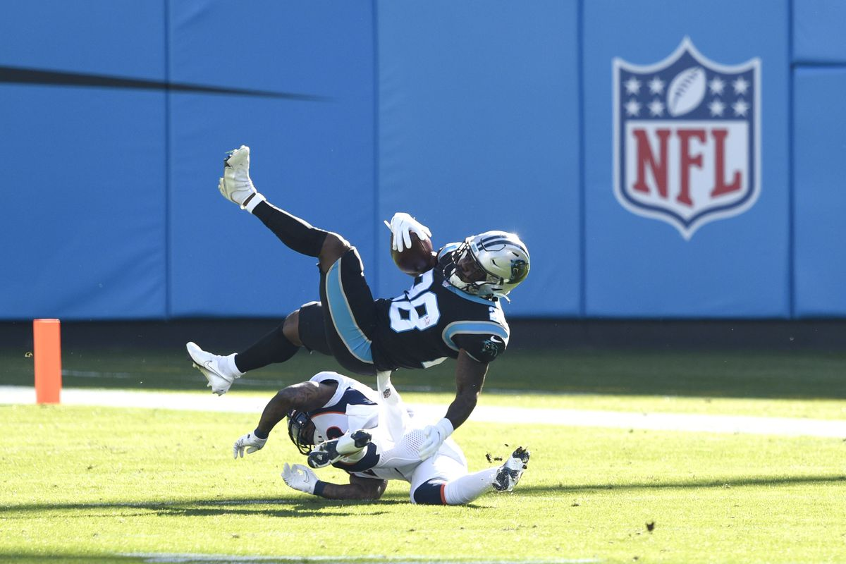 Carolina Panthers running back Mike Davis (28) is tackled by Denver Broncos safety Kareem Jackson (22) in the first quarter at Bank of America Stadium.