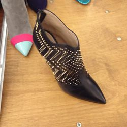 Black leather studded booties, $500