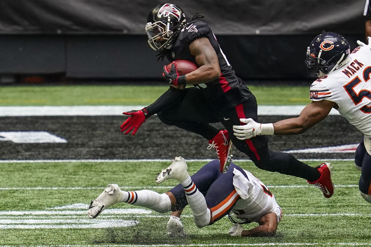 Atlanta Falcons running back Todd Gurley II jumps over Chicago Bears cornerback Kyle Fuller during the fourth quarter at Mercedes-Benz Stadium