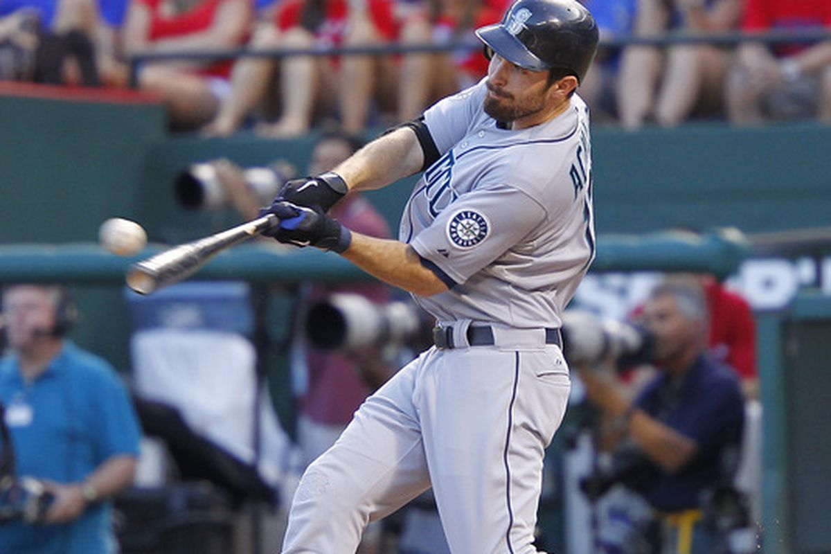 ARLINGTON, TX - MAY 30:  Ackley #13 of the Seattle Mariners hits a home run in the second inning against the Texas Rangers at Rangers Ballpark in Arlington on May 30, 2012 in Arlington, Texas. (Photo by Rick Yeatts/Getty Images)