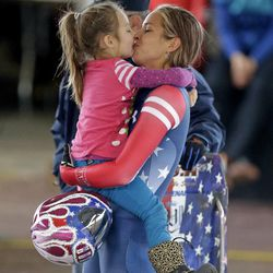 Noelle Pikus-Pace receives a kiss from her daughter Lacee, 5, after competing in the United States women's skeleton team trials Monday, Oct. 28, 2013, in Park City, Utah. Noelle Pikus-Pace came in first place after 2 heats.