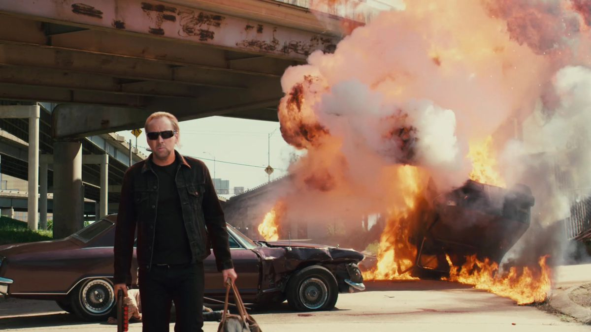 nicolas cage walking away from an exploded car fire in drive angry