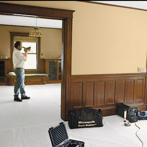 <p>To start his energy audit, Torrey replaced a porch door with a blower fan so he could lower the air pressure in the house and force outside air to be pulled in through uninsulated spots. Then he used an infrared camera to see where air from the hot outdoors was infiltrating the cool house.</p>