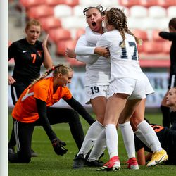 Ridgeline's Adeline Fiefia, left, and Marley Guevara celebrate after Fiefia scored the game-winning goal, giving her team a 3-2 lead over Ogden with under 4 minutes left, in the 4A girls soccer state championship game at Rio Tinto Stadium in Sandy on Friday, Oct. 23, 2020.