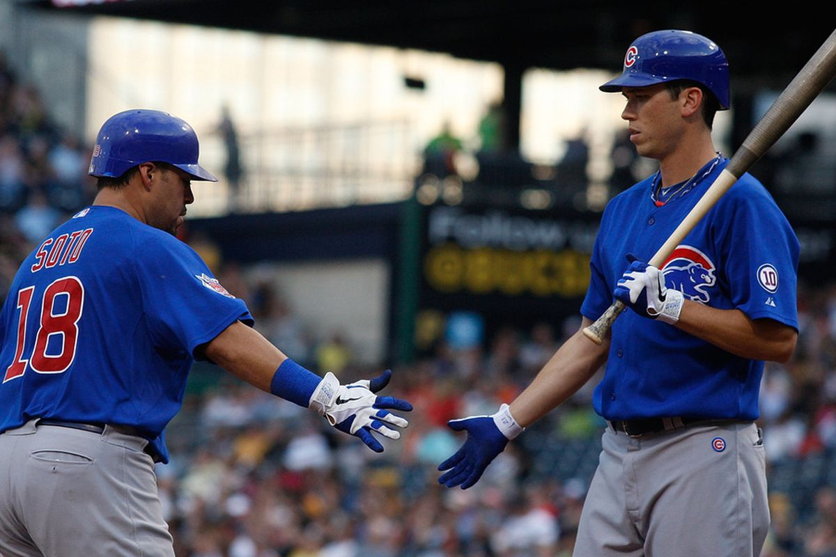 Geovany Soto of the Chicago Cubs is congratulated by teammate Tyler Colvin after hitting a solo home run against the Pittsburgh Pirates during a game at PNC Park in Pittsburgh, Pennsylvania.  (Photo by Jared Wickerham/Getty Images)