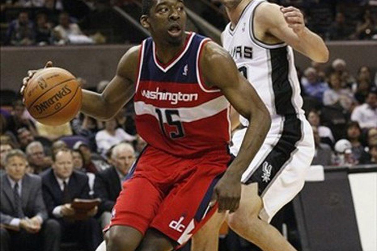 Mar 12, 2012; San Antonio, TX, USA; Washington Wizards guard Jordan Crawford (15) drives around San Antonio Spurs guard Manu Ginobili (right) during the second half at the AT&T Center. Mandatory Credit: Soobum Im-US PRESSWIRE