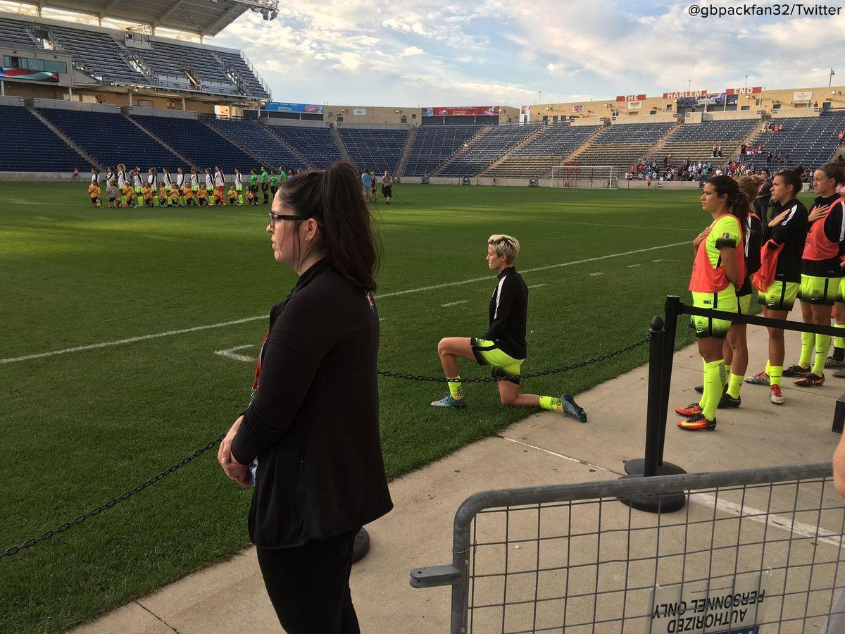 Megan Rapinoe kneels during the National Anthem