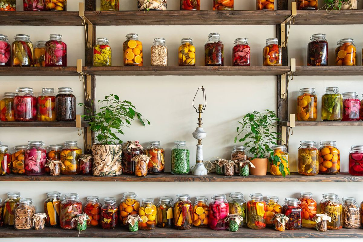 Wall of jarred sauces and vegetables at Cesarina