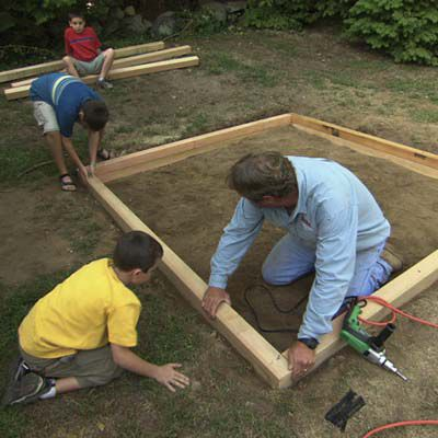 Man Laying Out Second Course For Sandbox