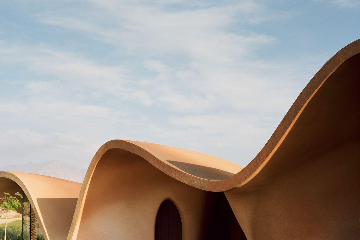 Orange concrete building in desert