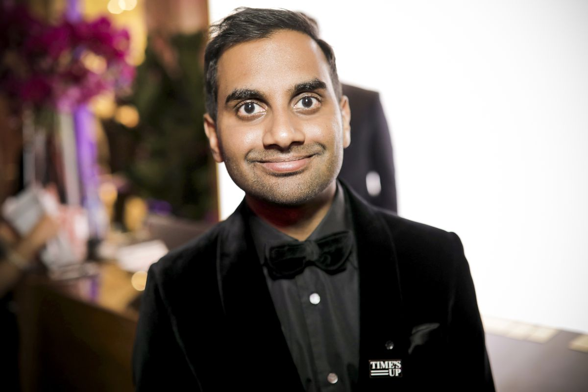 """Aziz Ansari dons a """"Time's Up"""" pin at The Golden Globe Awards on January 7, 2018 in Beverly Hills, California."""