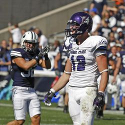 Weber State Wildcats safety Tony Epperson (12) after failing to run for a first down as Brigham Young University defeats Weber State University in football 45-6 Saturday, Sept. 8, 2012, in Provo, Utah.