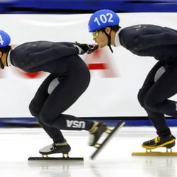 Thomas Insuk Hong (104) and John-Henry Krueger (102) competes in the men's 1000-meters during the U.S.Olympic short track speedskating trials Sunday, Dec. 17, 2017, in Kearns, Utah. (AP Photo/Rick Bowmer)
