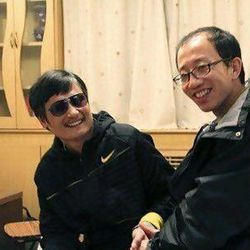 This undated photo provided by the China Aid Association shows blind Chinese legal activist Chen Guangchen, left, with Hu Jia sometime after Chen escaped house arrest on April 22, 2012. Activists say Chen, a well-known dissident who angered authorities in rural China by exposing forced abortions, is under the protection of U.S. diplomats in Beijing, posing a delicate diplomatic crisis for both governments.