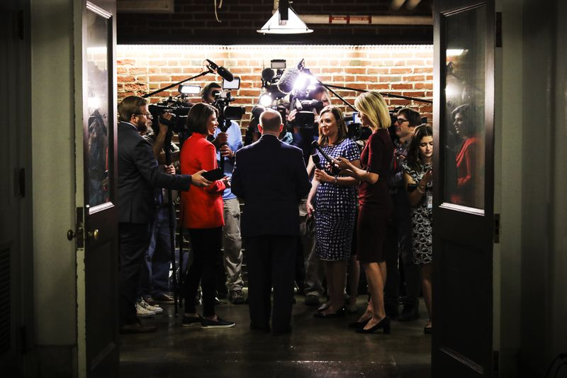 Senate Judiciary Committee member Sen. Chris Coons (D-DE) talks to journalists in the basement of the Russell Senate Office Building as he heads for a vote October 03, 2018.