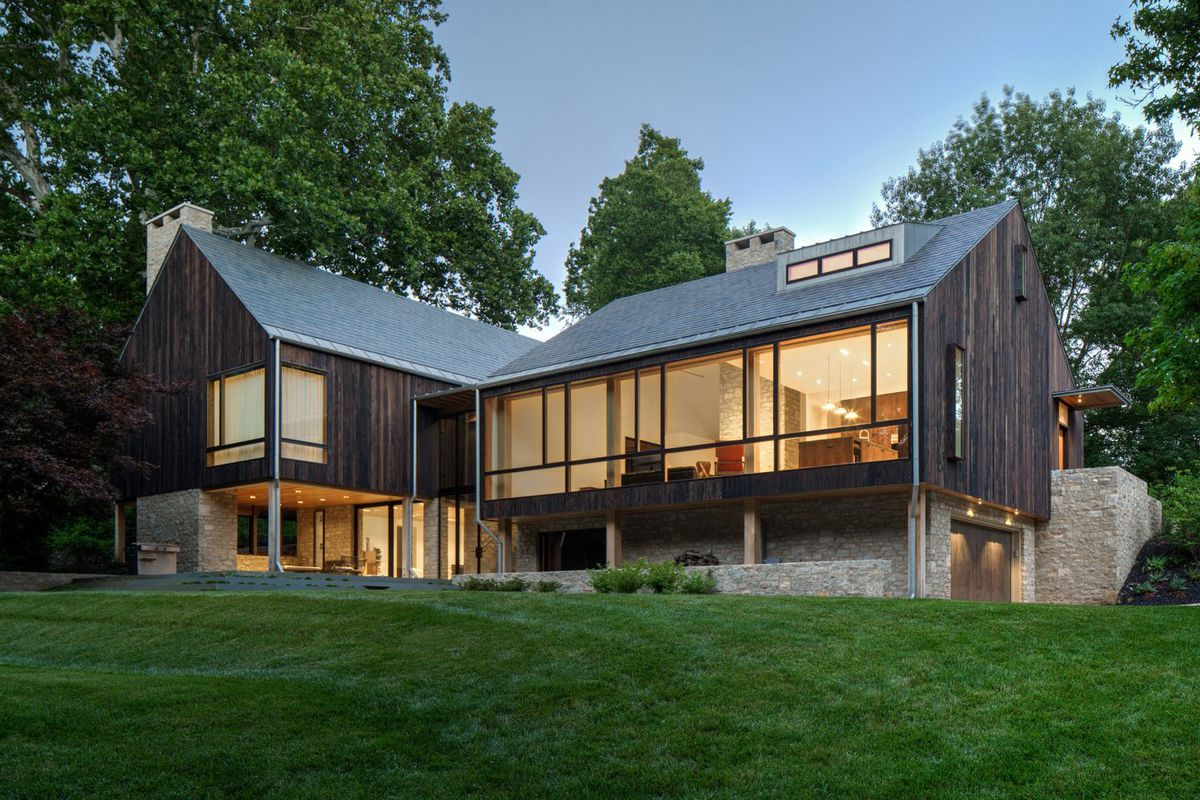 Modern farmhouse highlights glass and charred timber curbed for Cheap barn style homes
