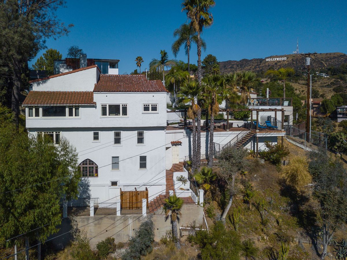 House with Hollywood sign behind it