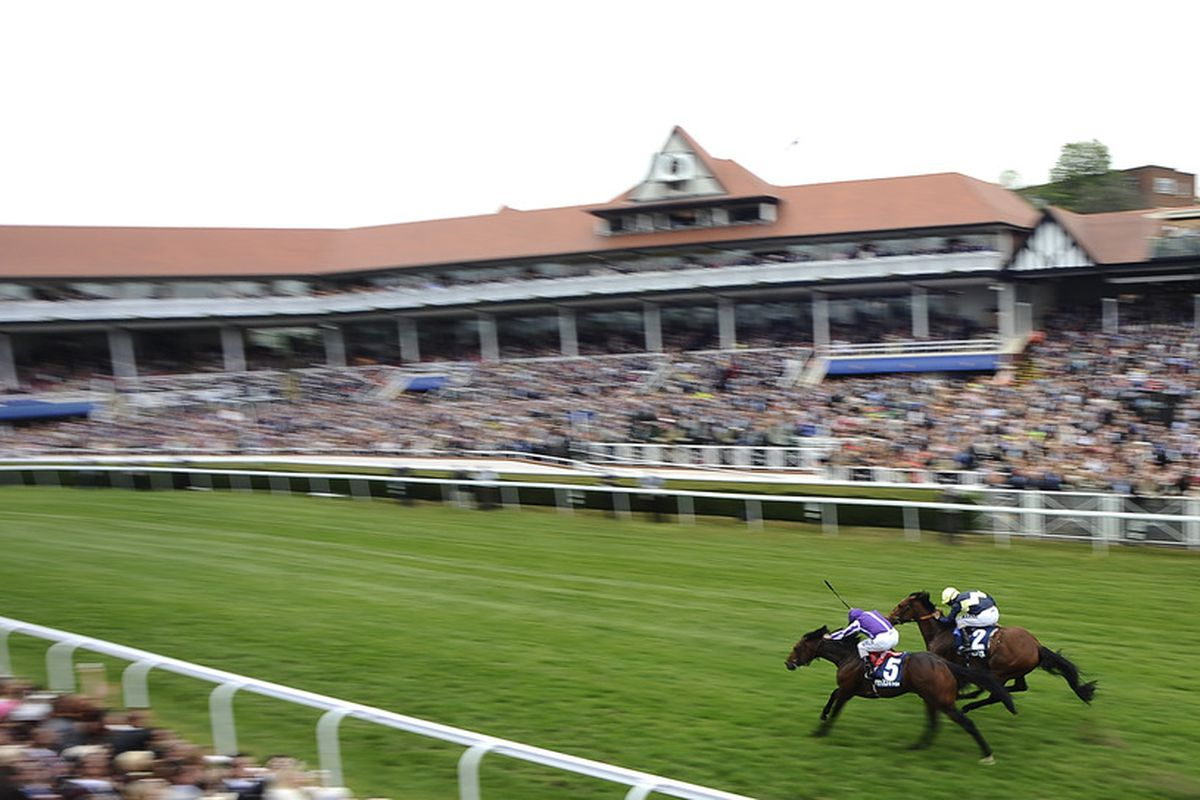 CHESTER, ENGLAND - MAY 05:  Ryan Moore riding Treasure Beach (L, purple) win The MBNA Chester Vase from Nathaniel (2nd L) at Chester racecourse on May 05, 2011 in Chester, England. (Photo by Alan Crowhurst/ Getty Images)