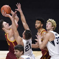 Southern California's Drew Peterson, left, goes up for a basket as BYU's Trevin Knell defends during game, Tuesday, Dec. 1, 2020, in Uncasville, Conn.