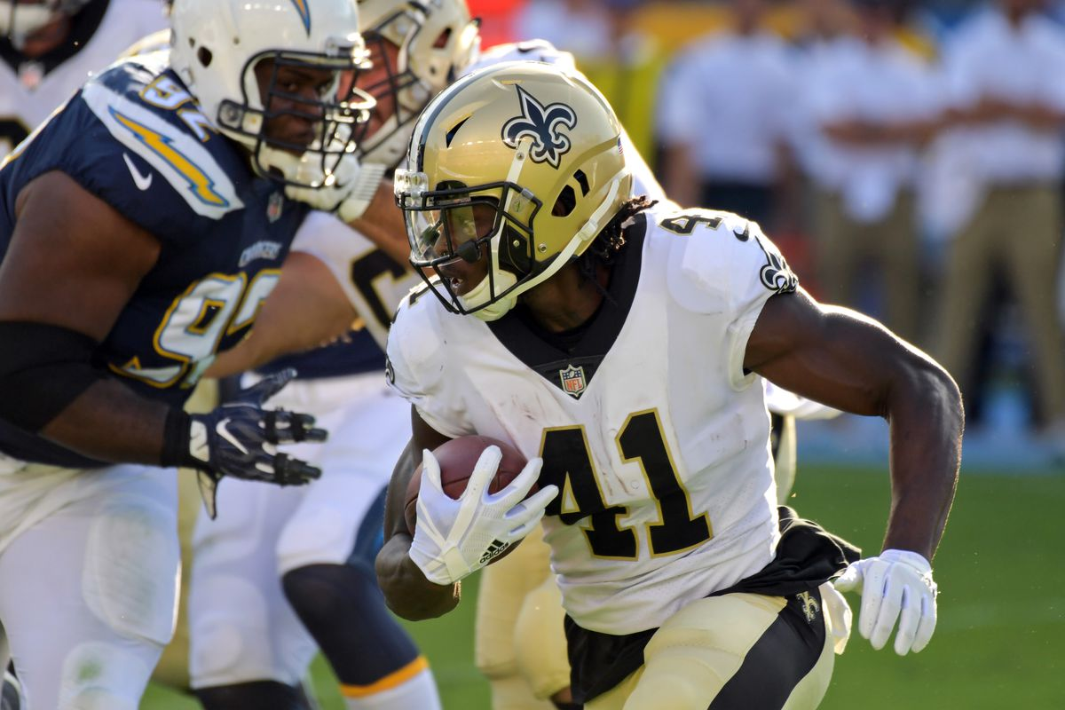 CARSON, CA:  New Orleans Saints rookie running back Alvin Kamara (41) rushes against the Los Angeles Chargers defense during an NFL preseason exhibition game at the StubHub Center.