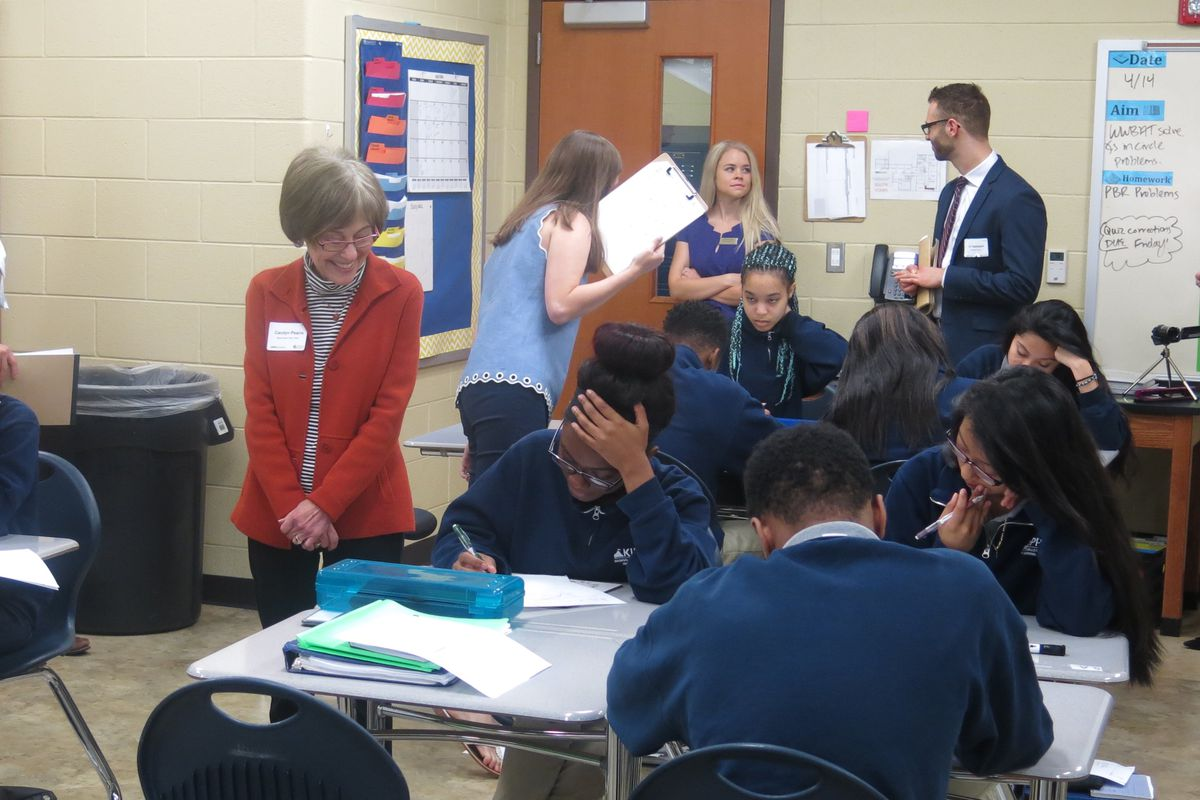 State Board of Education member Carolyn Pearre (left) observes students in a 10th-grade geometry class at KIPP Collegiate High School in East Nashville. KIPP Nashville's newest schools will be in the State Board school district.