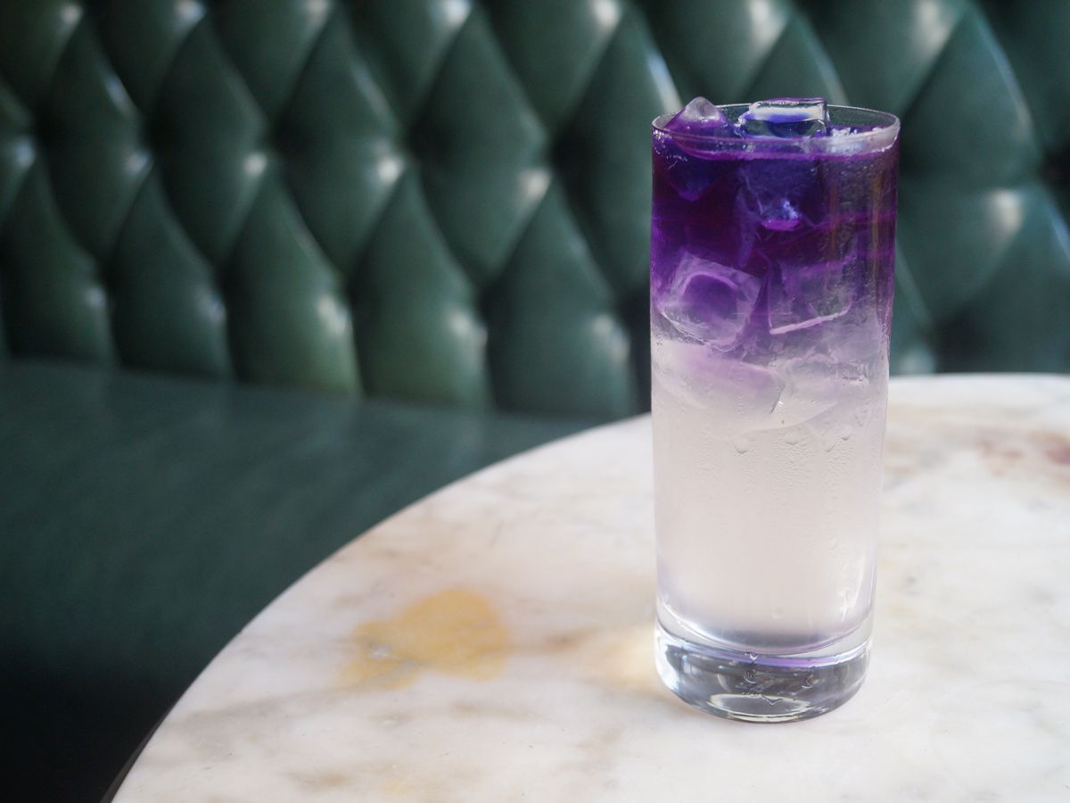 glass with clear and purple layered drink