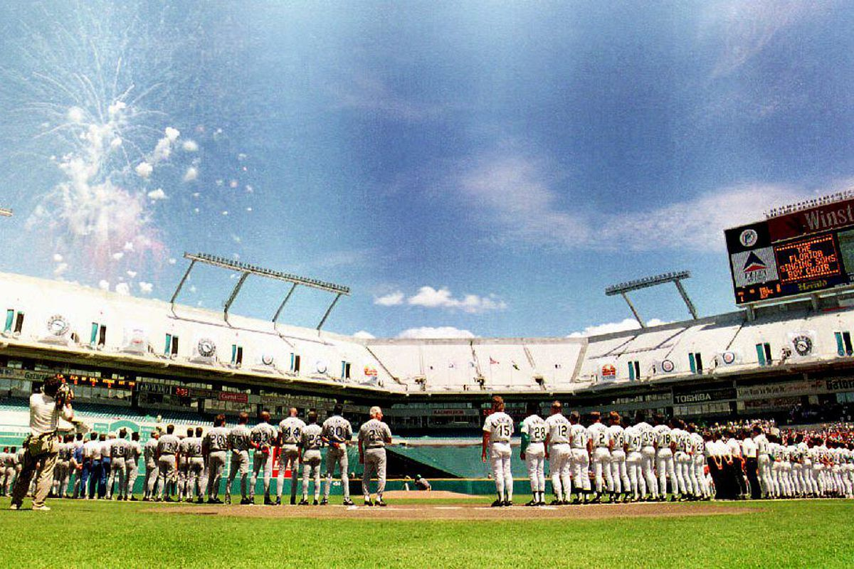 The expansion Florida Marlins (R) listen to the Na