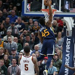 Utah Jazz guard Donovan Mitchell (45) dunks during the game against the Cleveland Cavaliers at Vivint Arena in Salt Lake City on Saturday, Dec. 30, 2017.