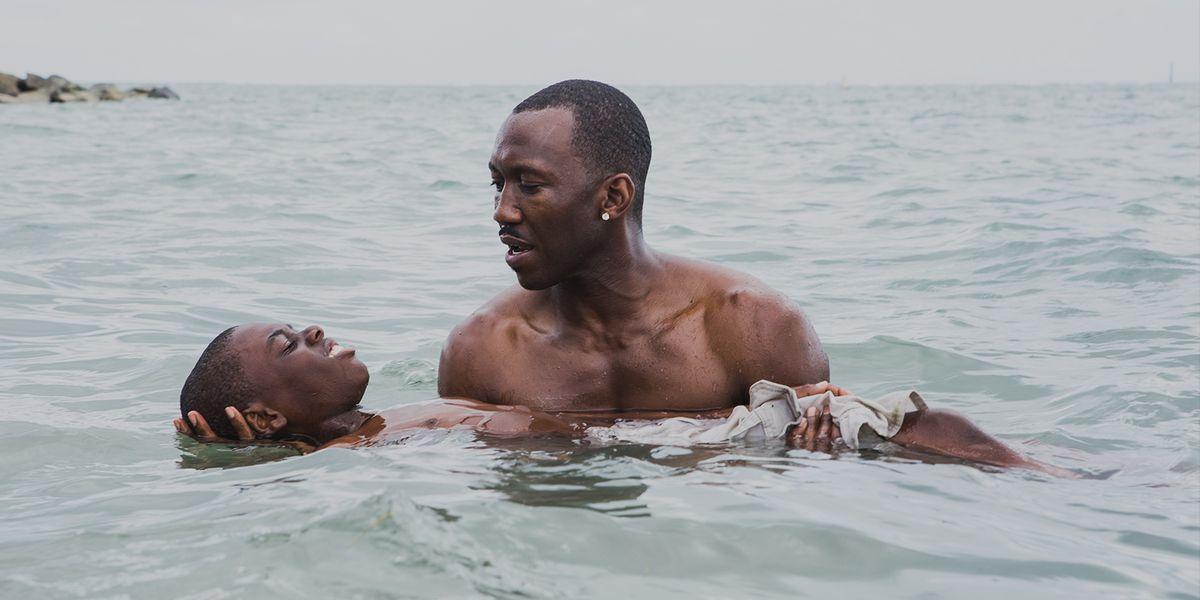 Juan (Ali) teaches Little (Hibbert) how to swim.