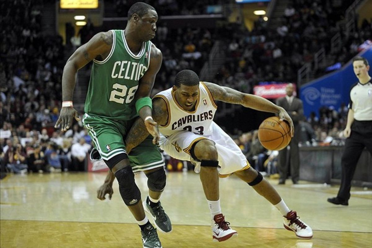 Feb 28, 2012; Cleveland, OH, USA; Cleveland Cavaliers small forward Alonzo Gee (33) drives against Boston Celtics small forward Mickael Pietrus (28) in the fourth quater at Quicken Loans Arena. Mandatory Credit: David Richard-US PRESSWIRE