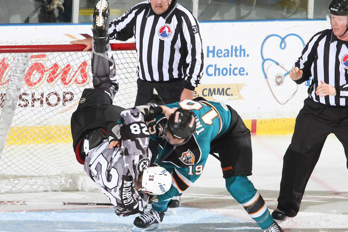Worcester Sharks second year forward Daniil Tarasov slams  Portland Pirates defenseman Connor Murphy to the ice during their firght at the end of the second period Friday night at the Androscoggin Bank Colisee.