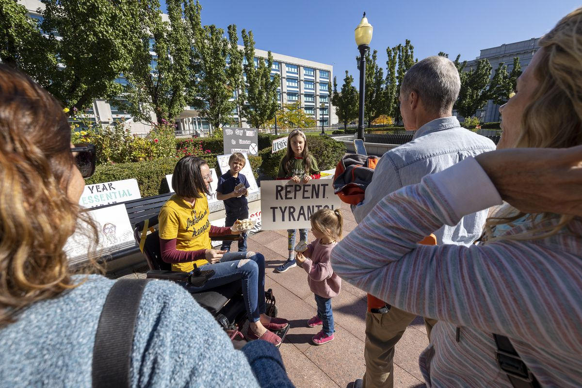 Several hundred show up to express their opinions on the Biden administration's vaccine mandate, at a meeting of The Business and Labor Interim Committee at the Capitol in Salt Lake City on Monday, Oct. 4, 2021.