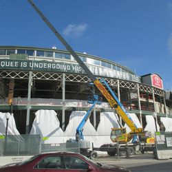 11:51 a.m. The crane working in the front of the ballpark -